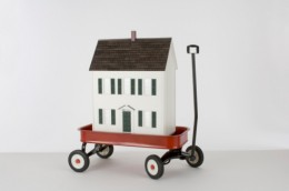 Miniature house in toy wagon