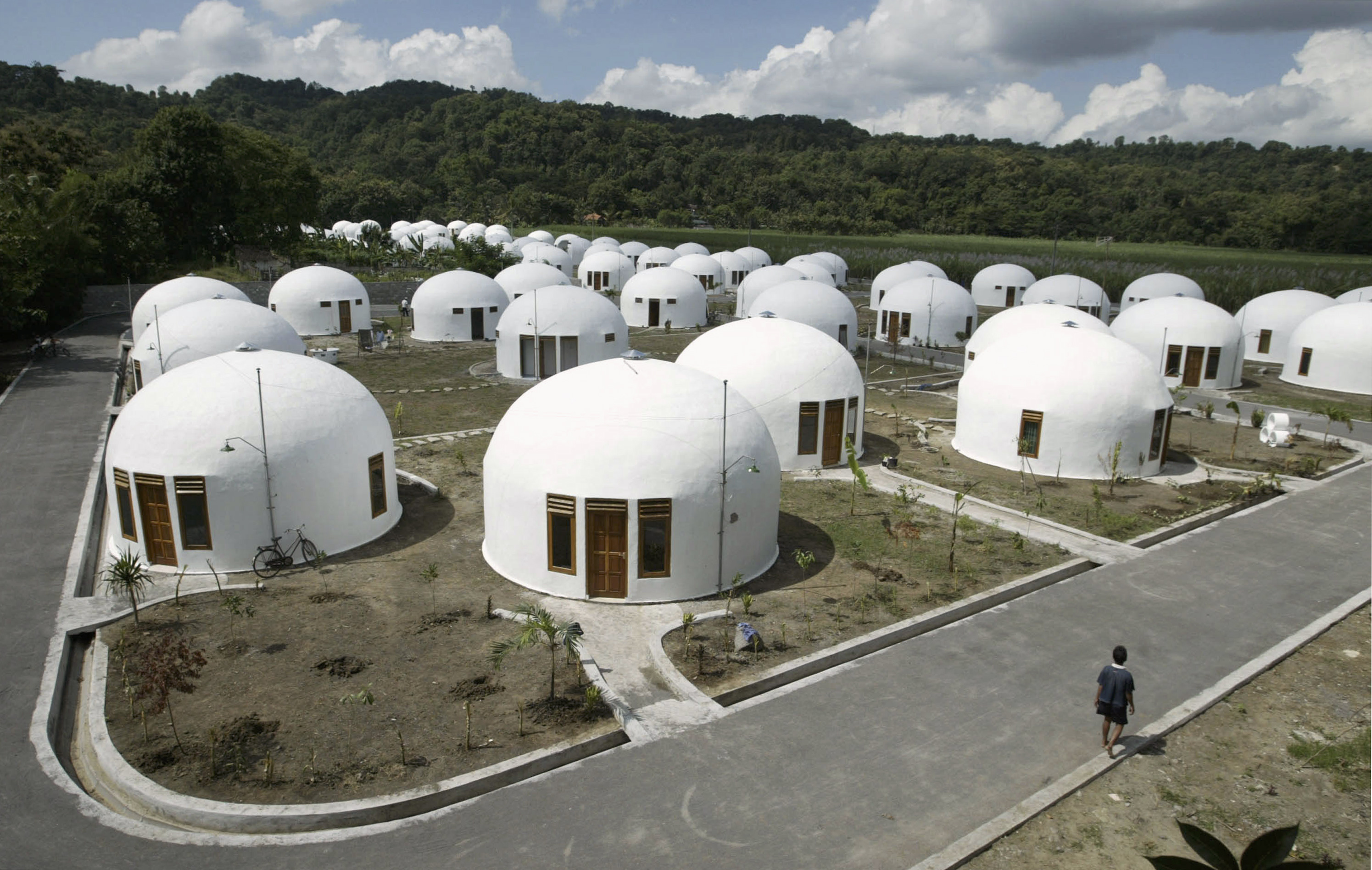 A view of about 70 domes houses, which were built by U.S. based Domes for the World, for villagers who lost their houses to last year's earthquake in Sumberharjo village, near Indonesia's ancient city of Yogyakarta, May 8, 2007. REUTERS/Dwi Oblo (INDONESIA) - RTR1PGGR