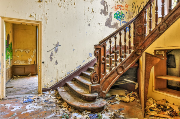 Decaying staircase in an abandoned manor
